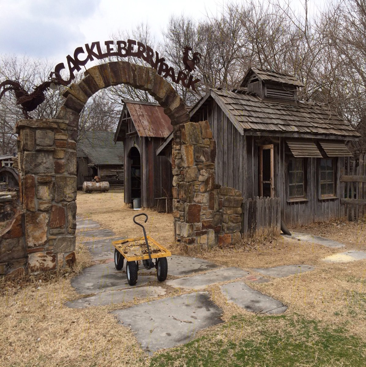Rustic chicken coop with metal sign