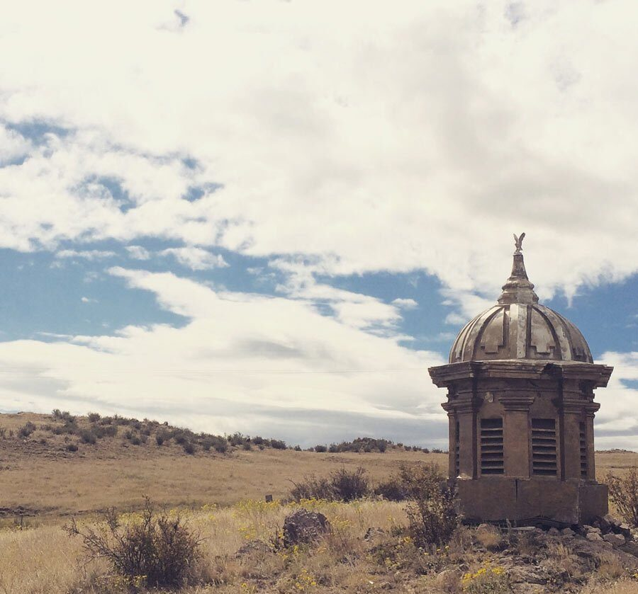 A cupola from a state capital in a field in Wyoming