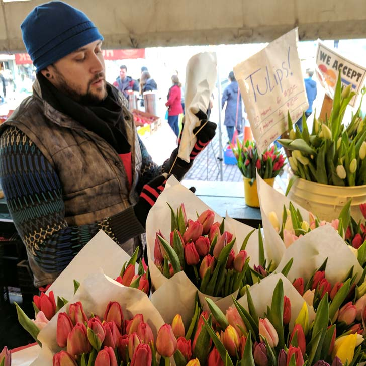 Bouquets being packaged at pike place market.