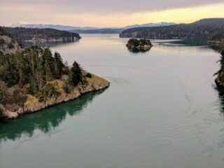 Deception Pass & The Cascade Mountains as seen from the bridge to Whidbey Island.