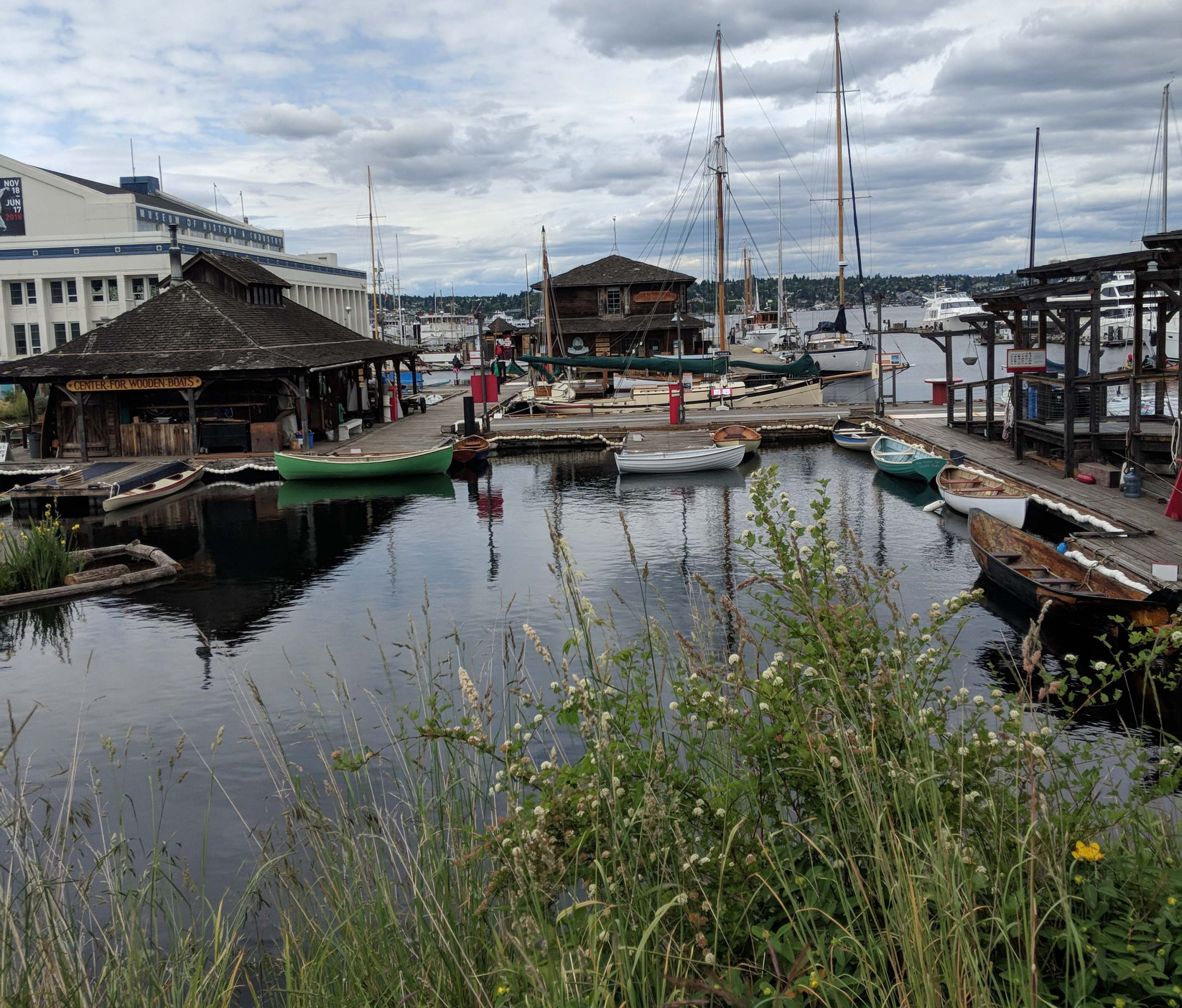 Slu's center for wooden boats featuring wood boats floating in calm waters.