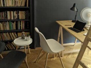 A laptop workspace in a modern short term rental apartment