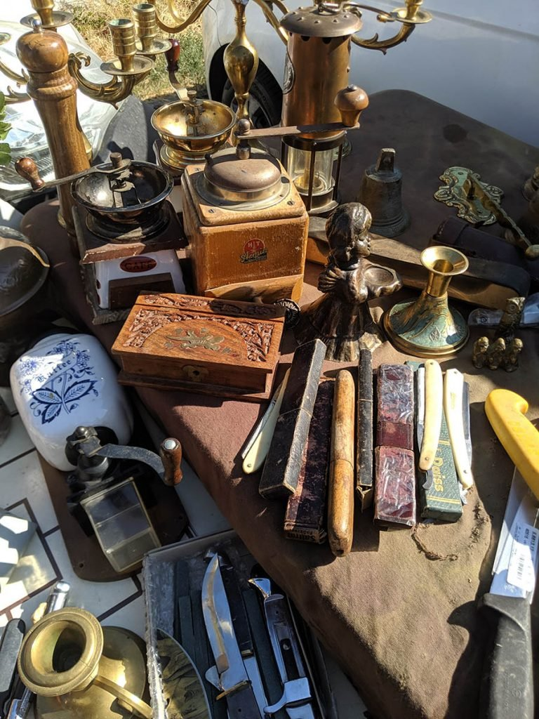 international flea markets can be a fun place to shop and learn about local culture for adventurous tourists