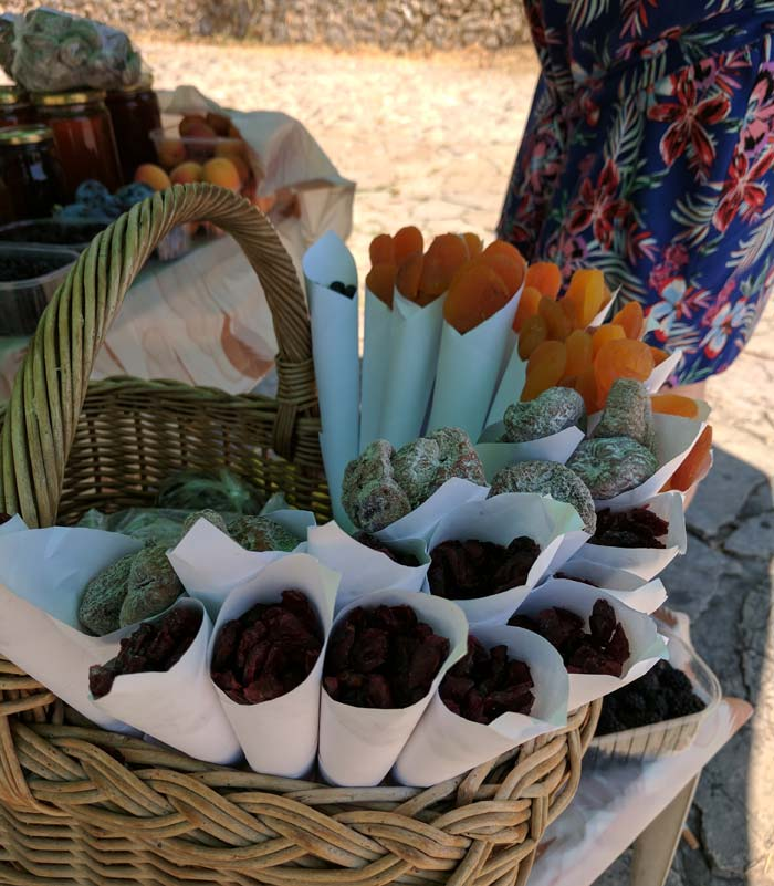 Dried fruits in a basket being sold on the street in bosnia.