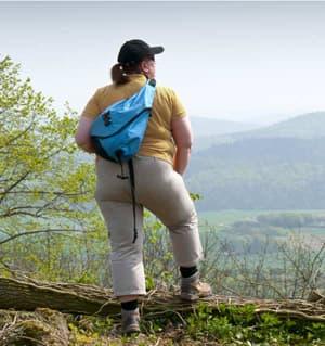 Plus size traveler at scenic overlook