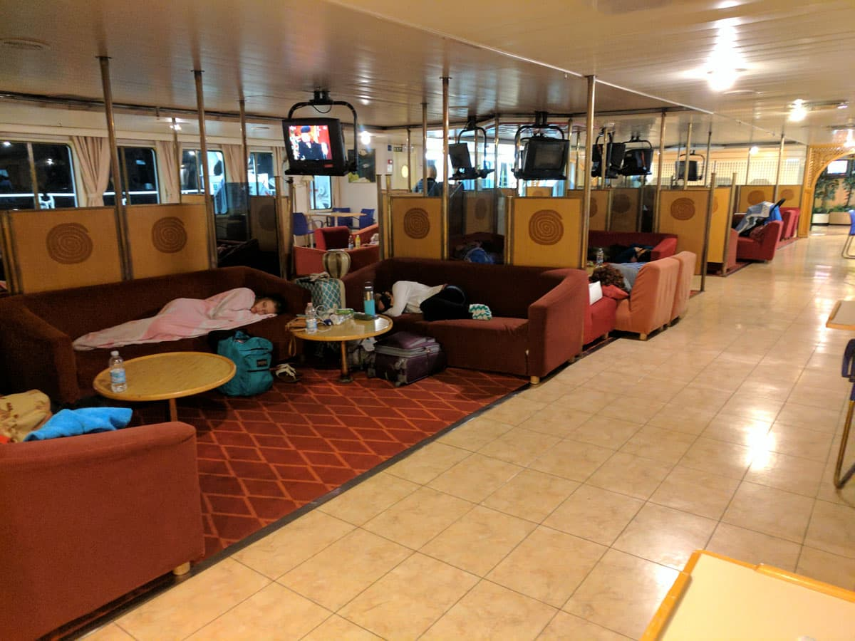 "Economy deck passengers sleeping on couches aboard ferry ""zadar"""