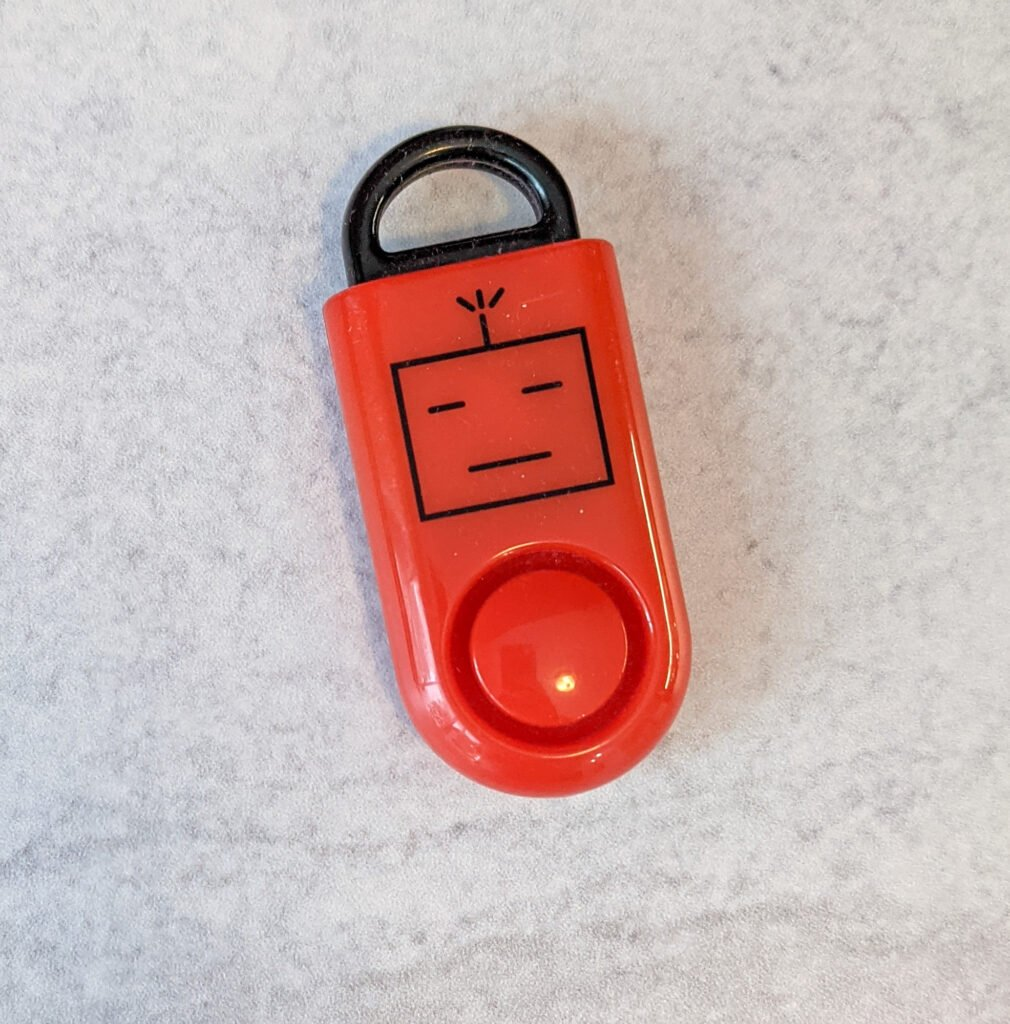 A personal travel alarm sounds a loud alarm if the black porion is removed from the red case.