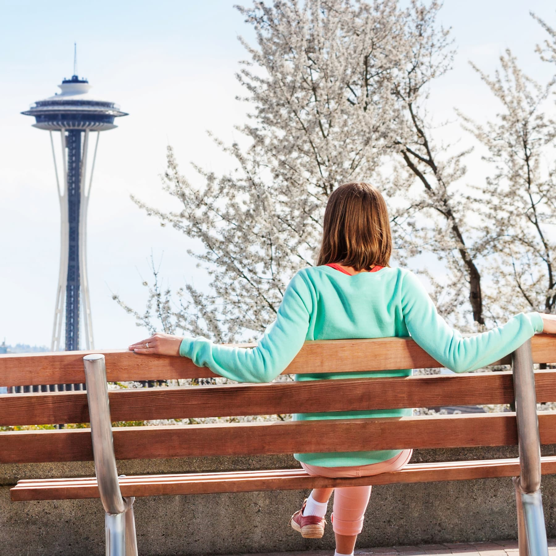 A woman sits alone on a bench in seattle, wa.