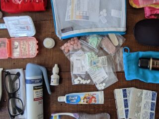 Packing list items laid out on a table.