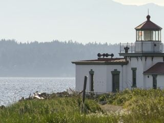 Discovery park's lighthouse on the shores of the Puget Sound in Seattle.
