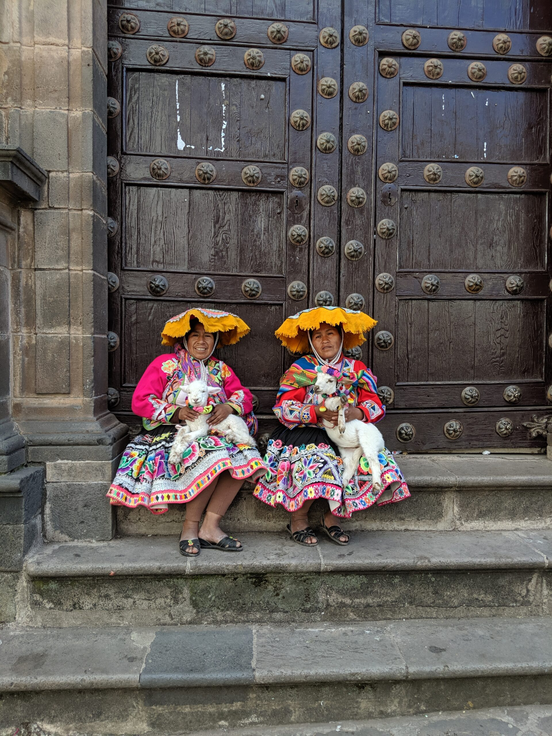 Two women pose in traditional peruvian clothing