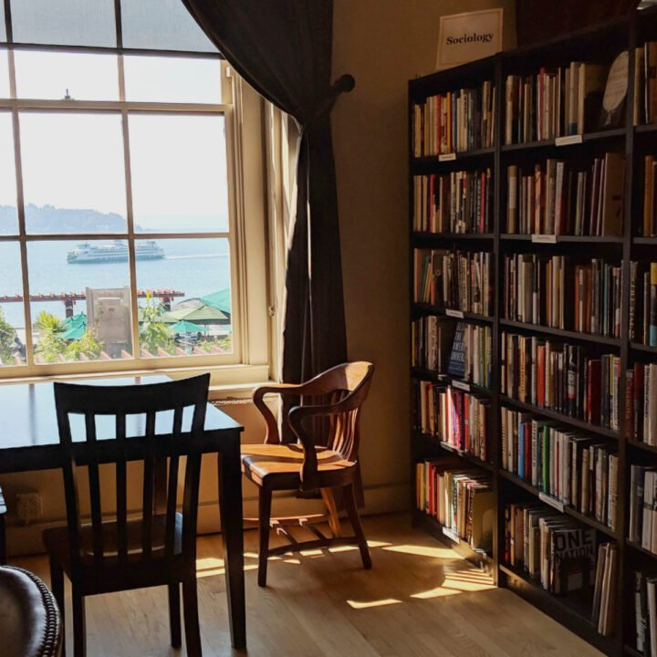 An old-fashioned library with a view of a Washington state ferry in the Puget Sound, located in Pike Place market.