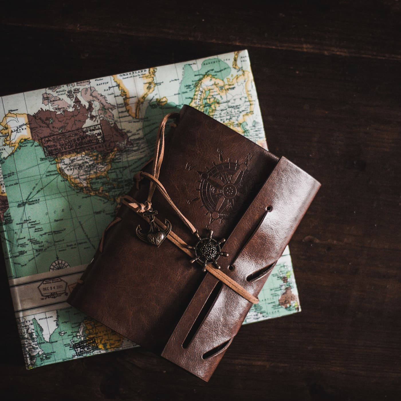 A travel journal and map on a dark background.