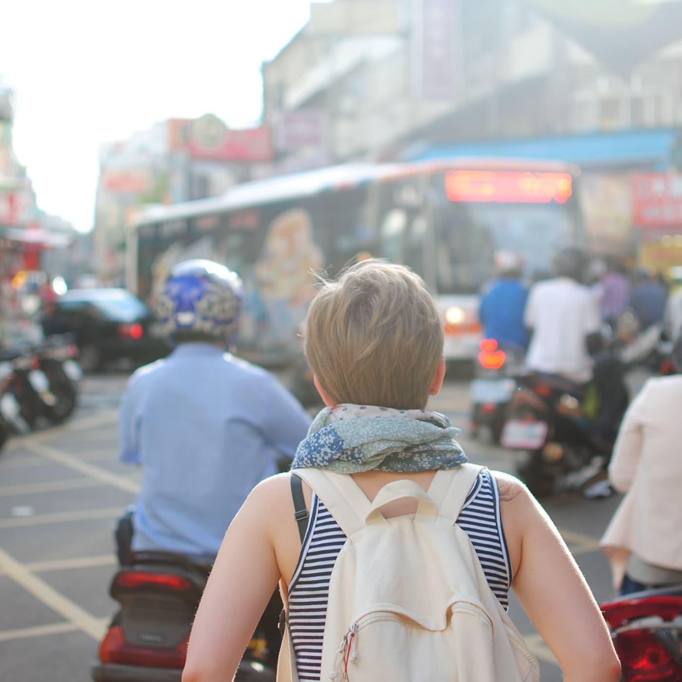 Woman walking in a crowd.