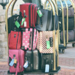 An image of a luggage cart filled with luggage.