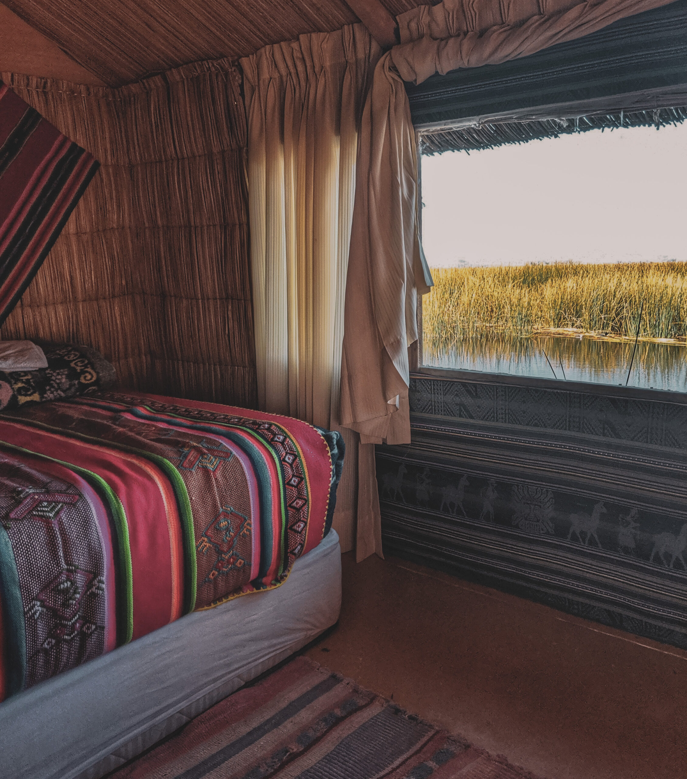 A bedroom in a guesthouse on an uros island.