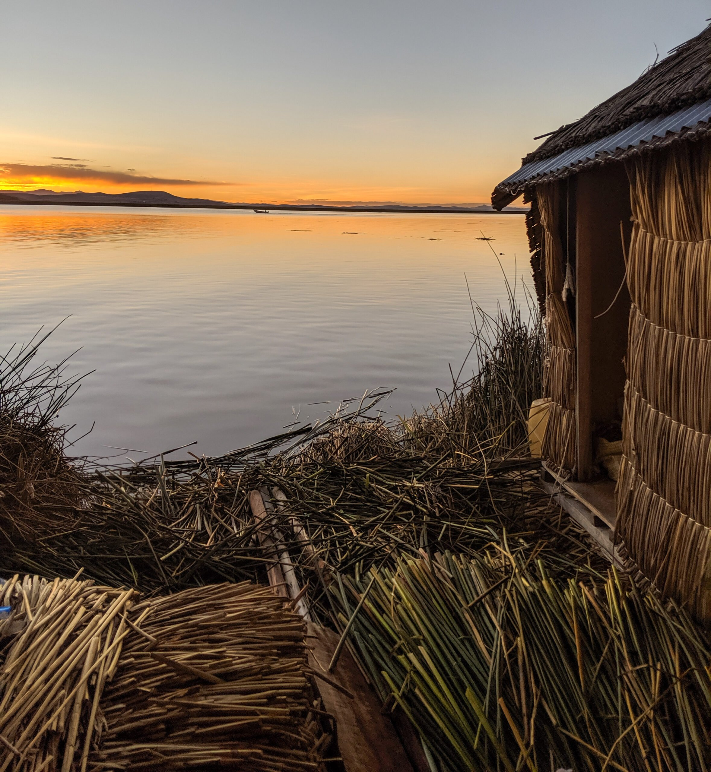 Sunset on a floating island in the uros village.