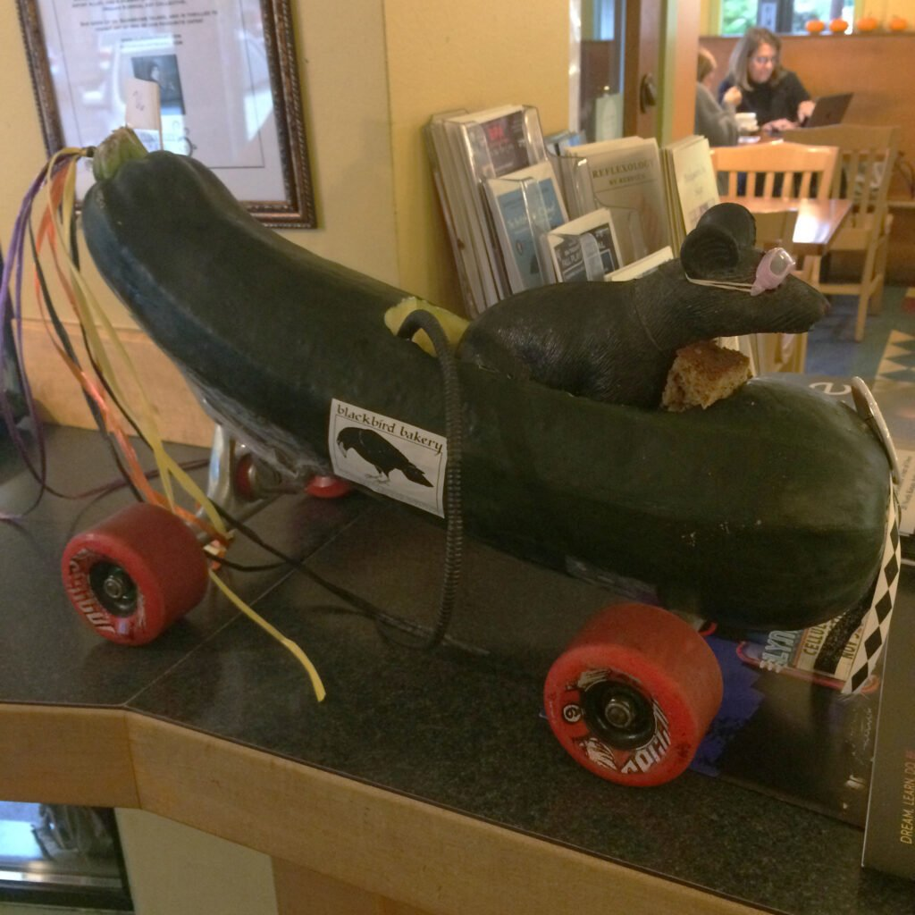 A plastic mouse in a racing zuchinni.