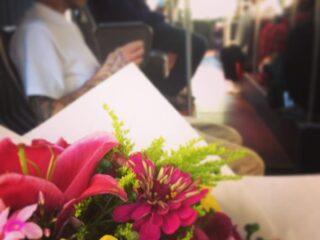 A bouquet of flowers on public transportation in Seattle.