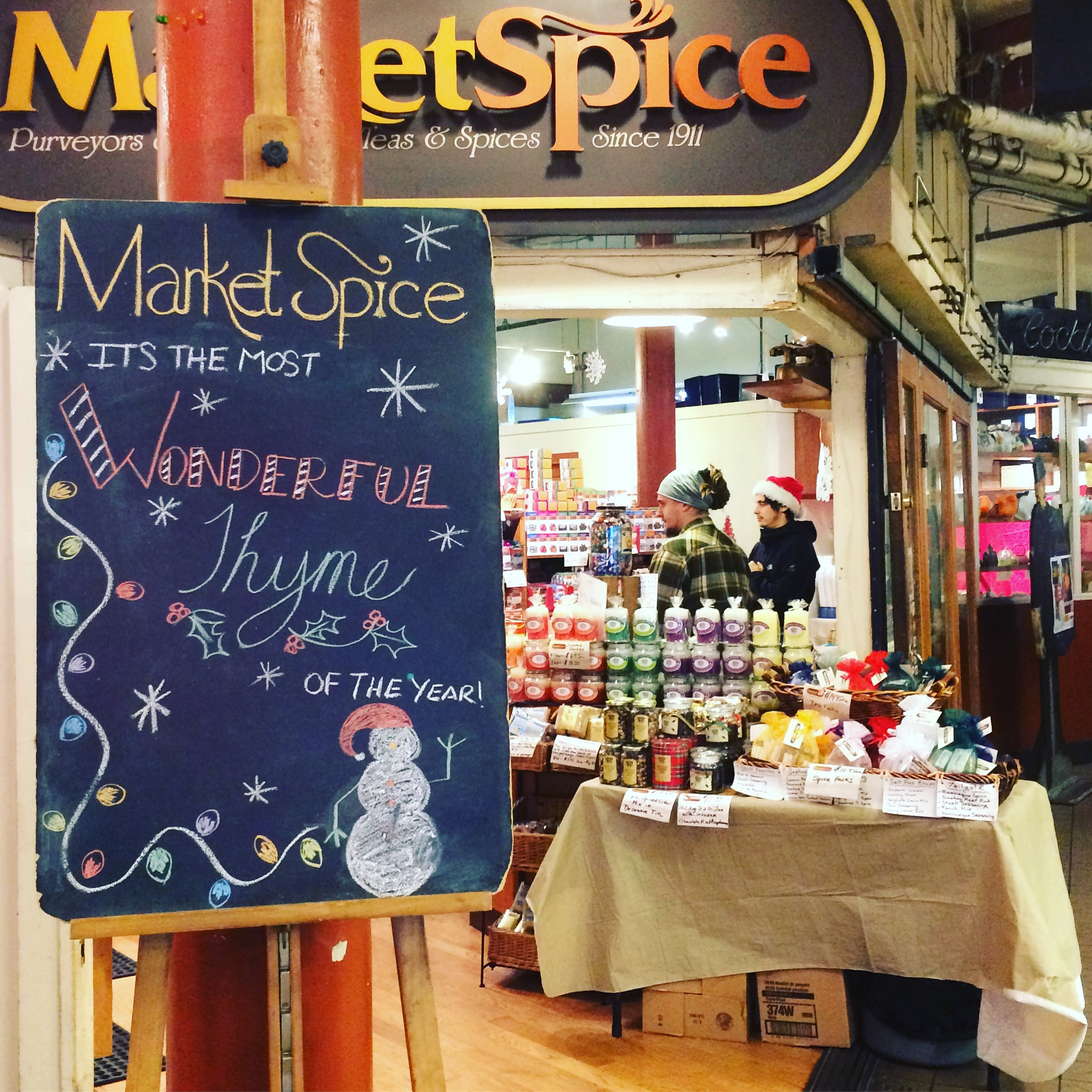 Pike place market herb store with christmas sign.