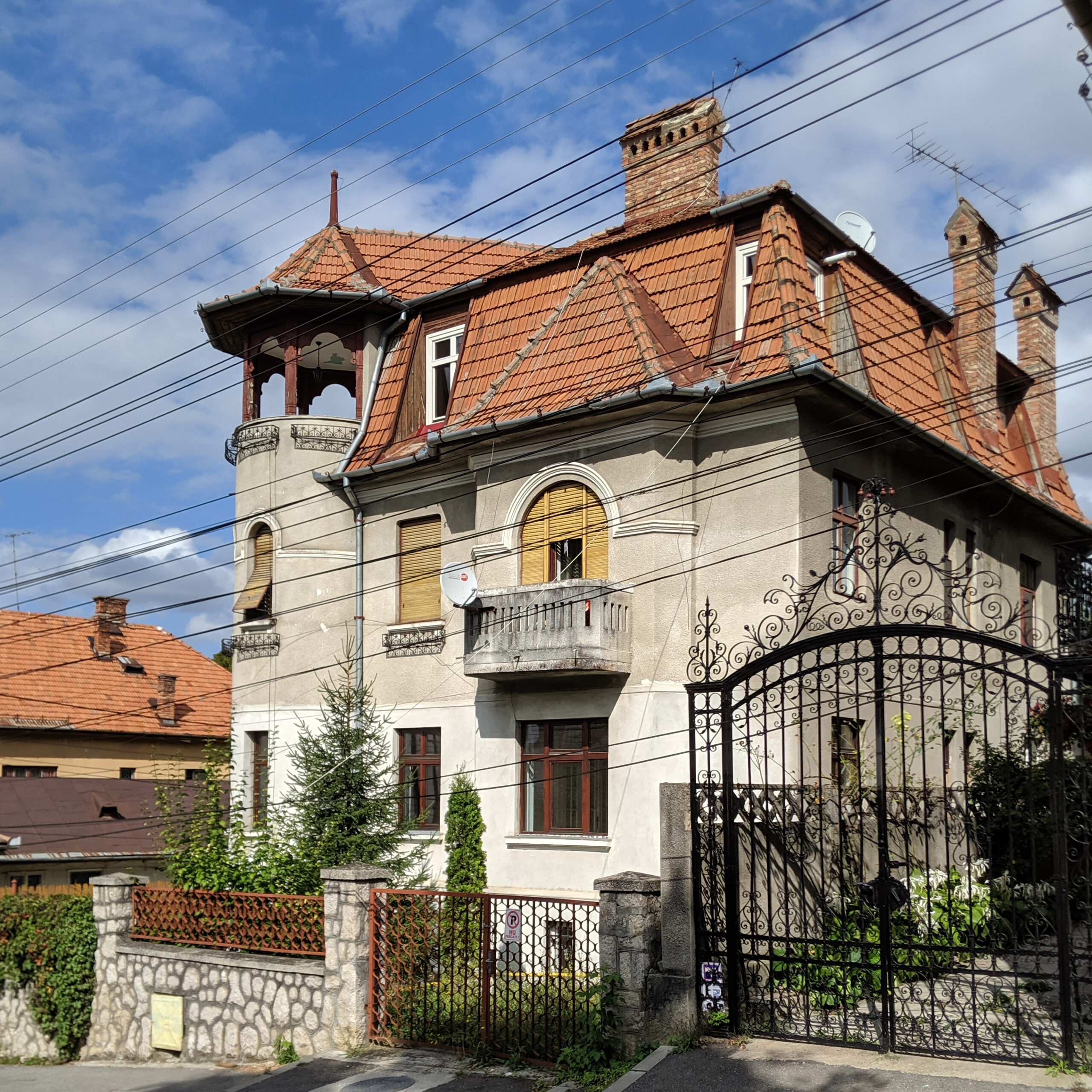 A historic home with balconies and gables in romania.