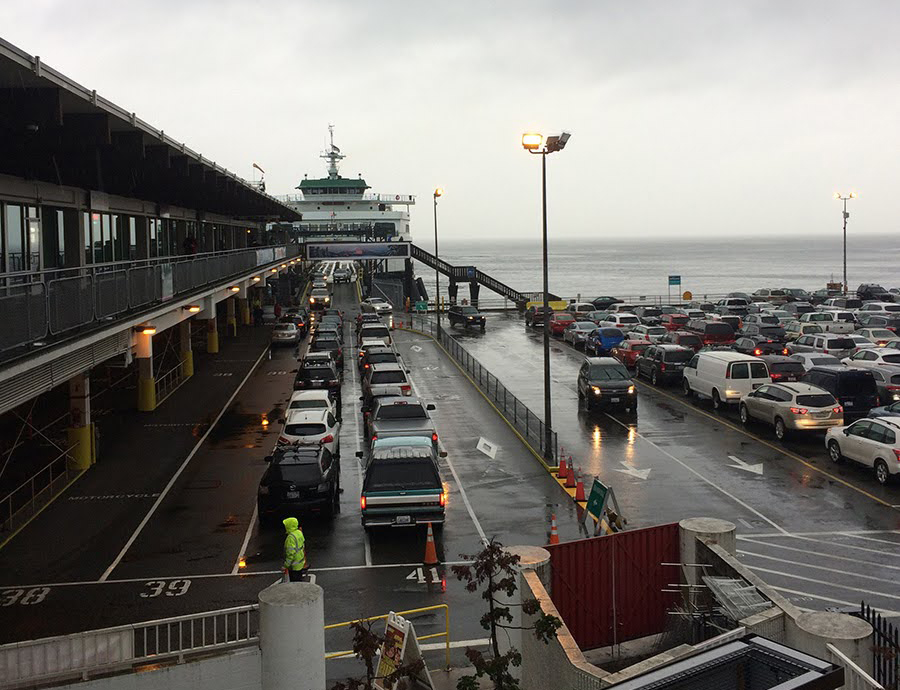 Cars lined up to board a washington state ferry bound for bainbridge island.