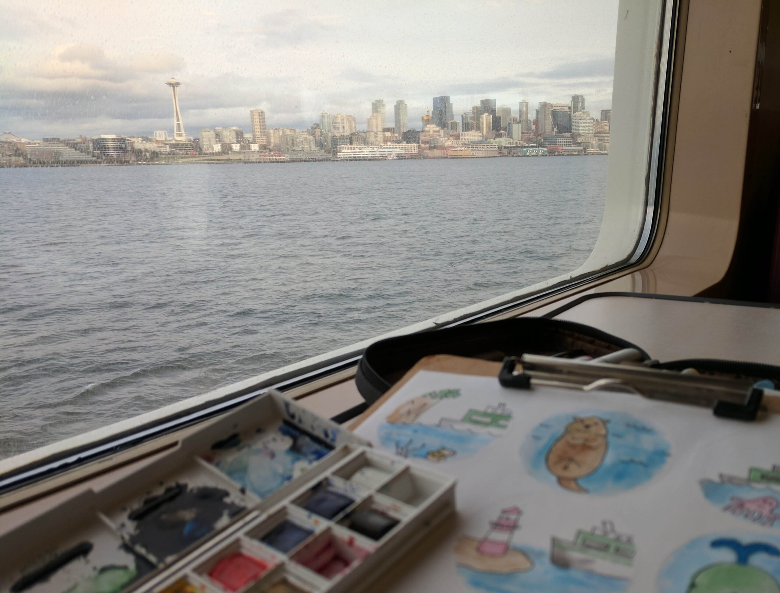 The space needle as seen from the bainbridge return washington state ferry.