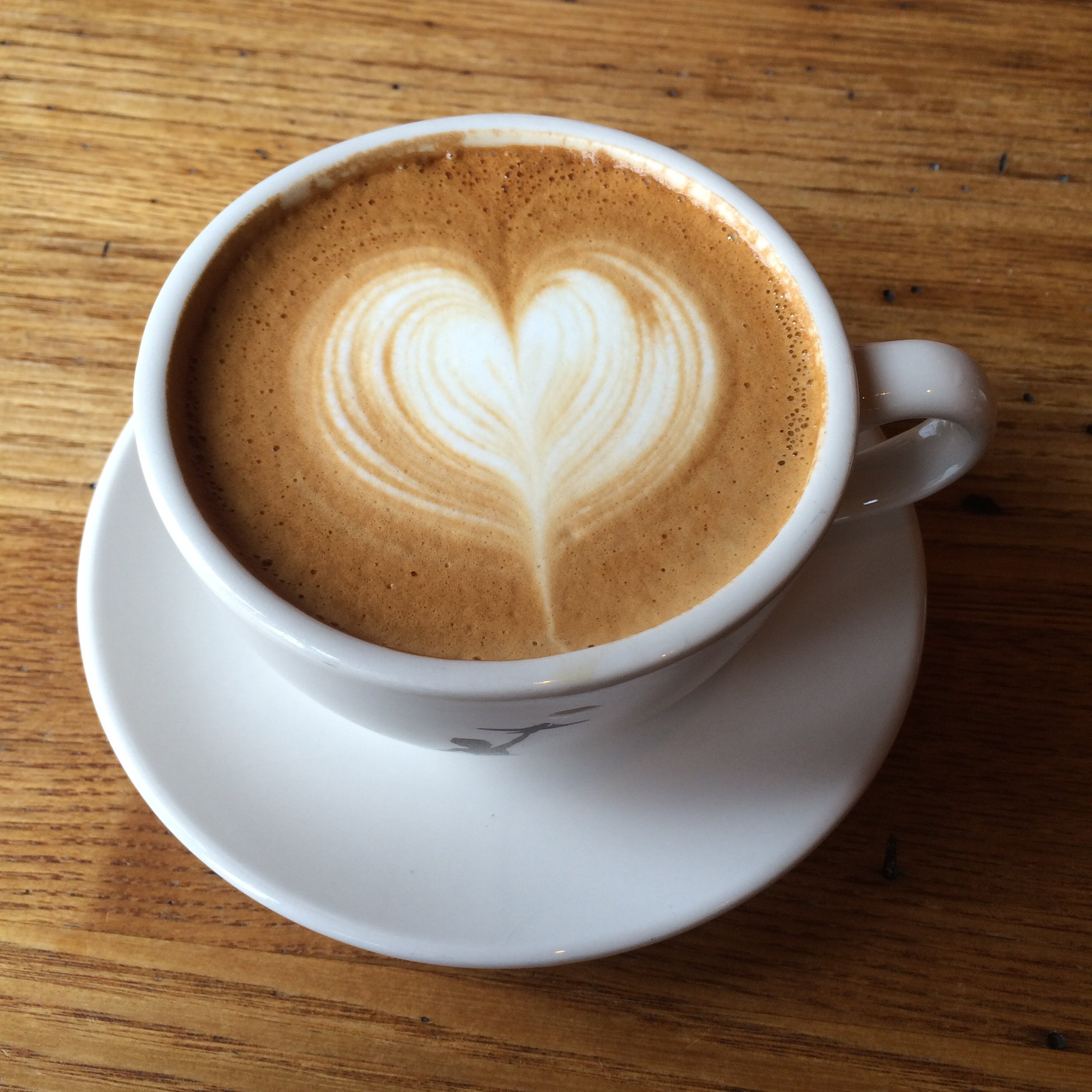 A latte with heart-shaped latte art.