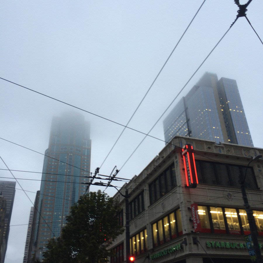 Fog obscures skyscrapers just outside of pike place market in seattle.
