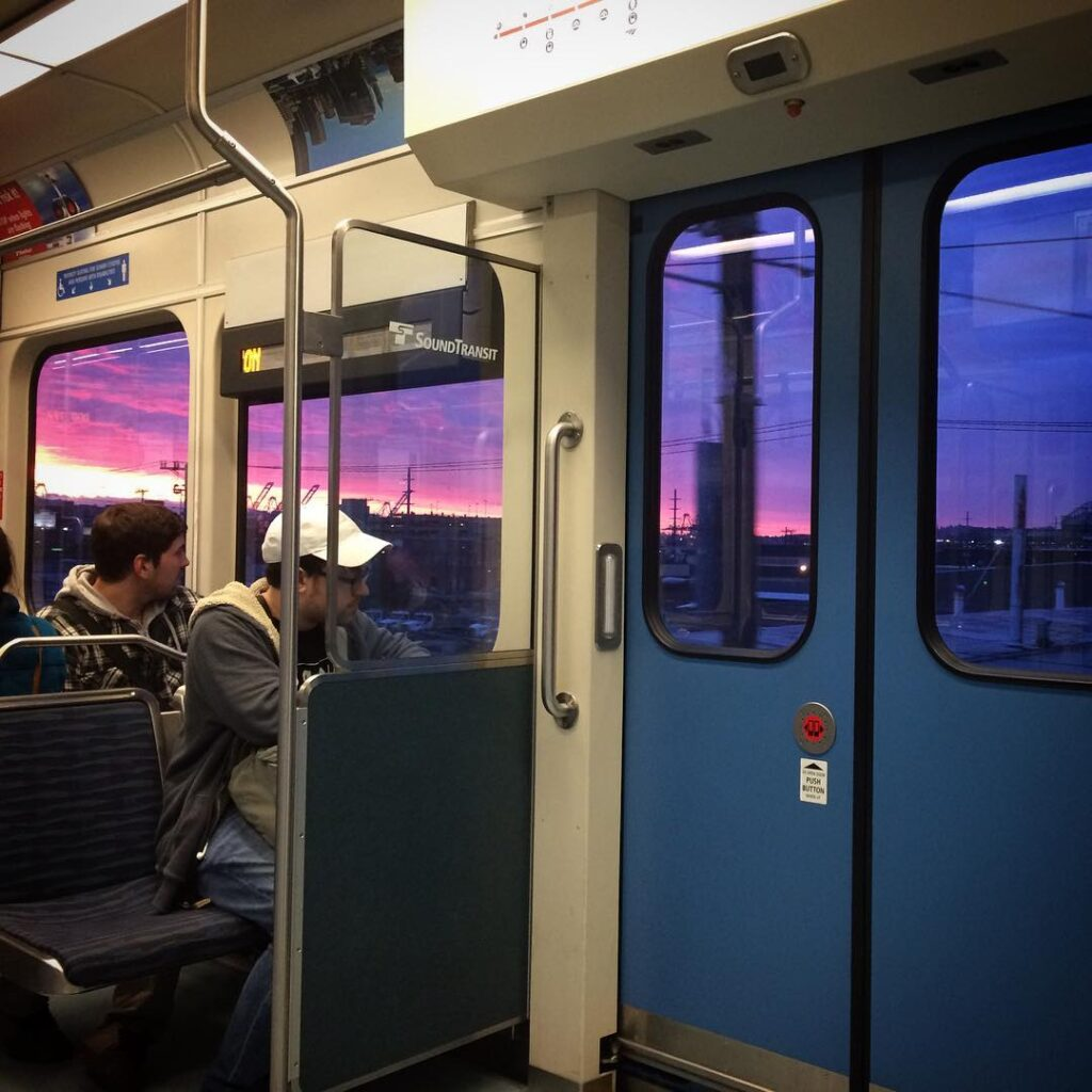 Sunset as seen from seattle's link sound transit light rail train.