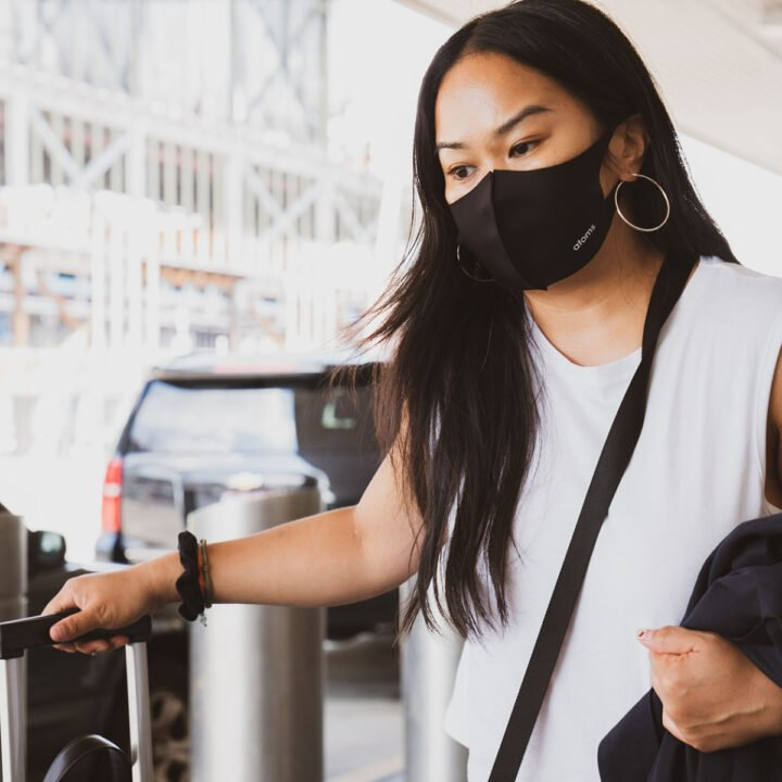 a masked woman traveling alone.
