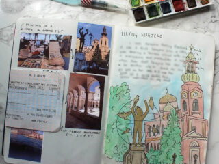 I learned how to make a travel scrapbook by trial and error, this sample layout shows writing, art, photos, and ticket stubs from Sarajevo, Bosnia.