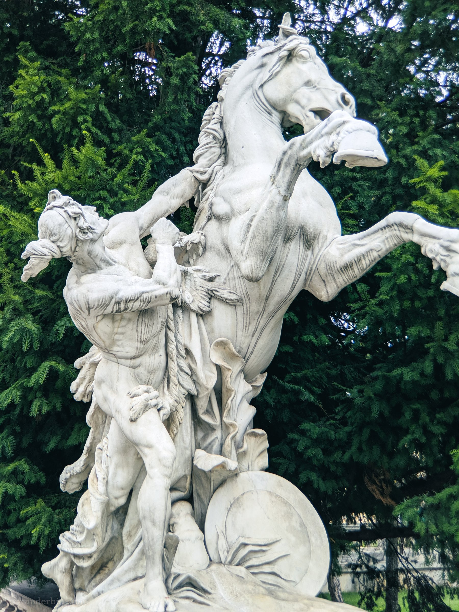 And equestrian statue near a tomb in eastern europe.