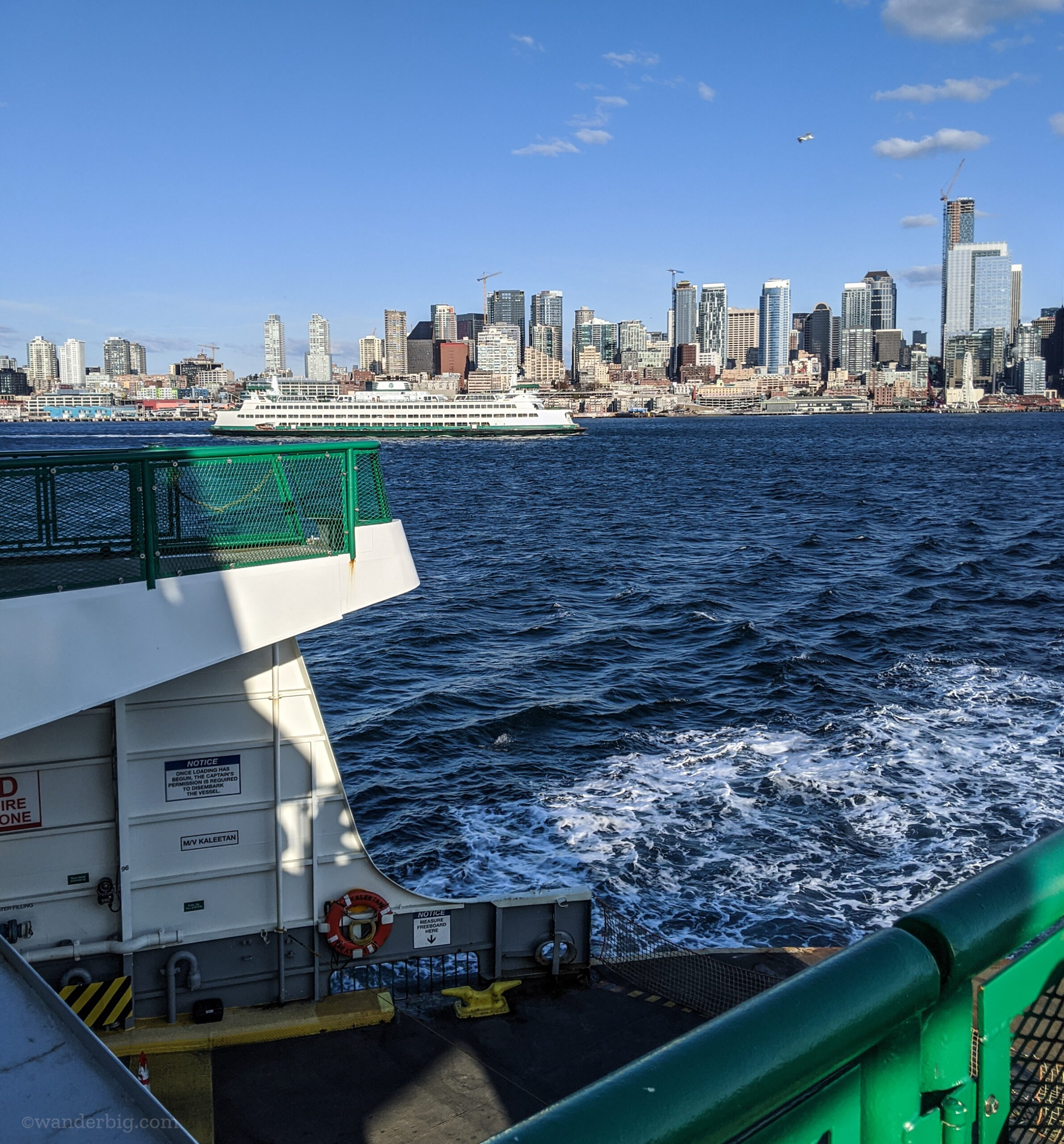 The seattle skyline as seen from an approach on the bainbridge to seattle ferry. Ferries are one way to navigate seattle without a car.