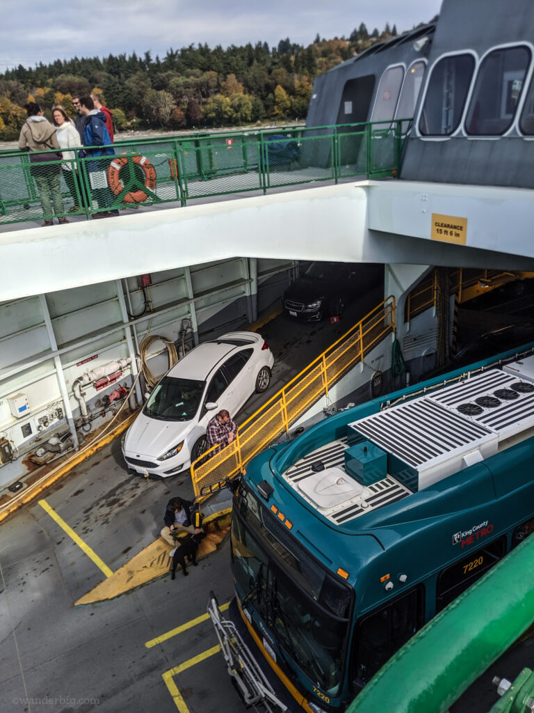 Cars, a bus, and foot passengers on a washington state ferry..