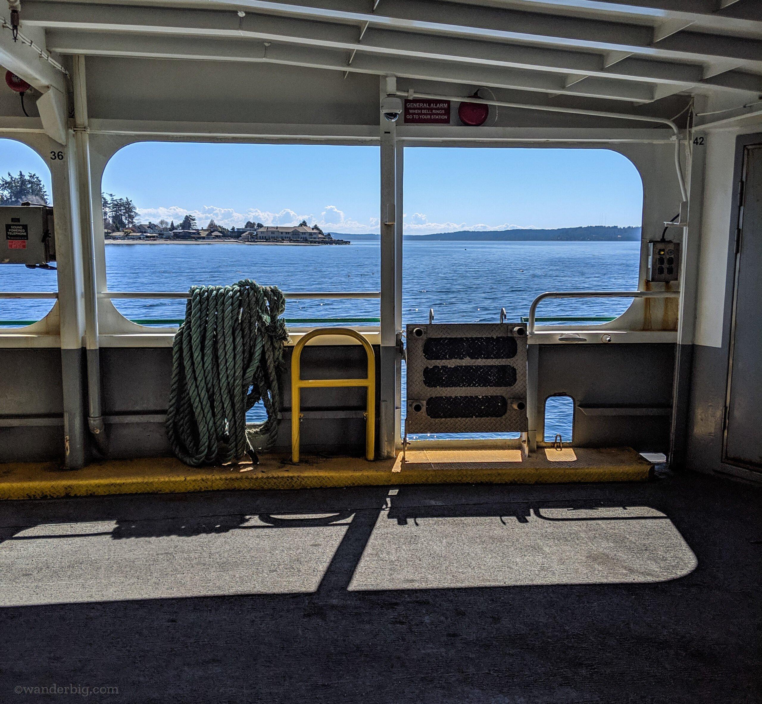 Bainbridge island as seen from the deck of a ferry.
