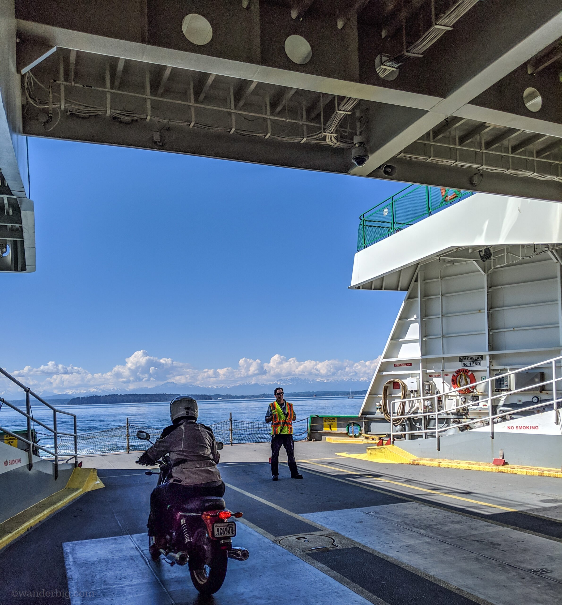 A motorcycle rider at the front of a washington state ferry.
