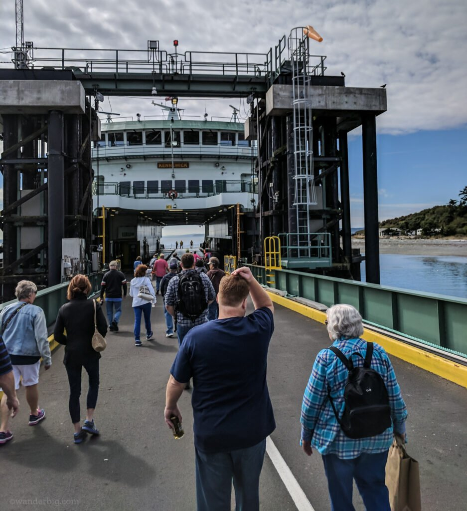 Foot passengers board a ferry in washington state.