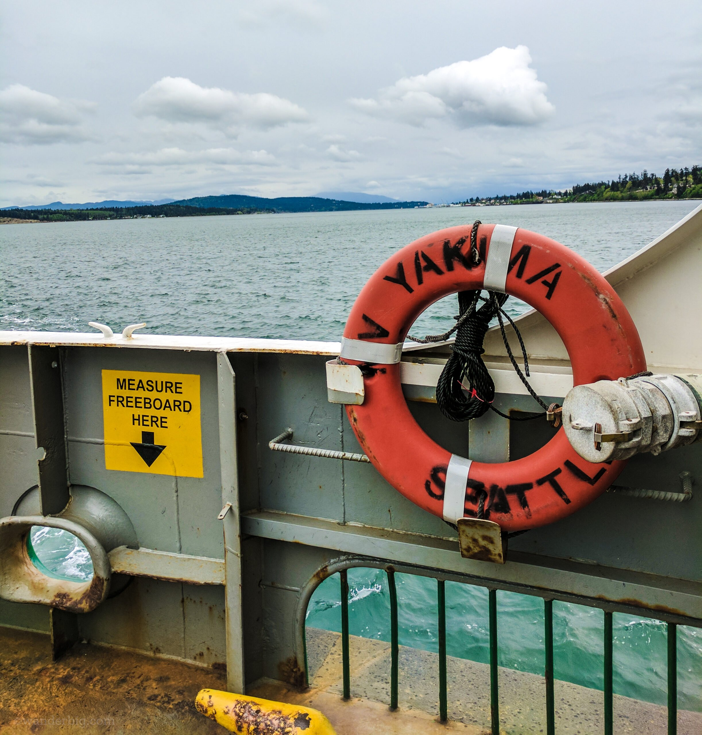 A view of the puget sound landscape over the side of a ferry.