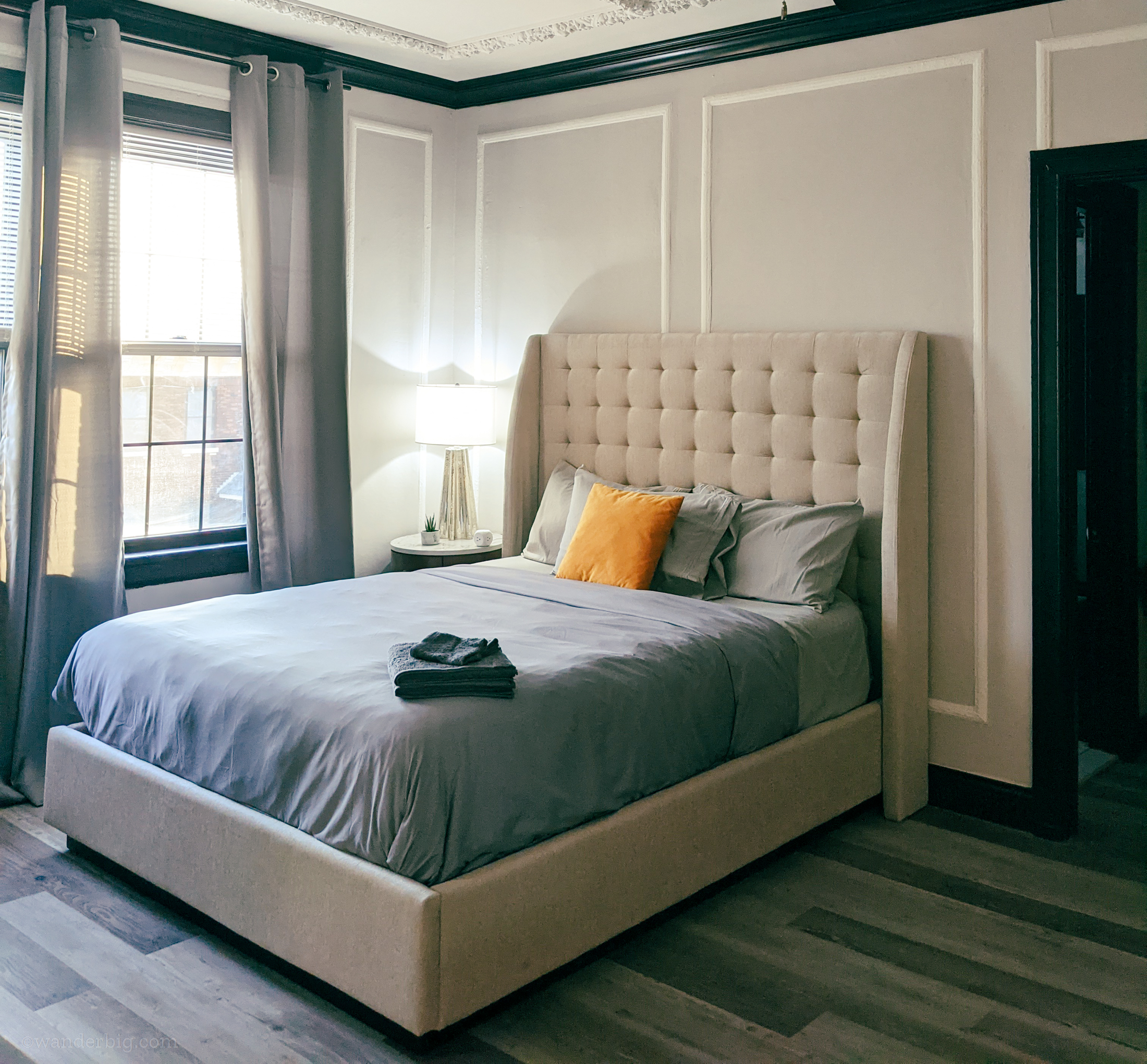 A bed in an airbnb apartment, illustrating the importance of selecting a comfortable space for a monthly airbnb stay.