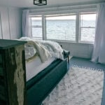 A bed overlooking the puget sound in an airbnb.