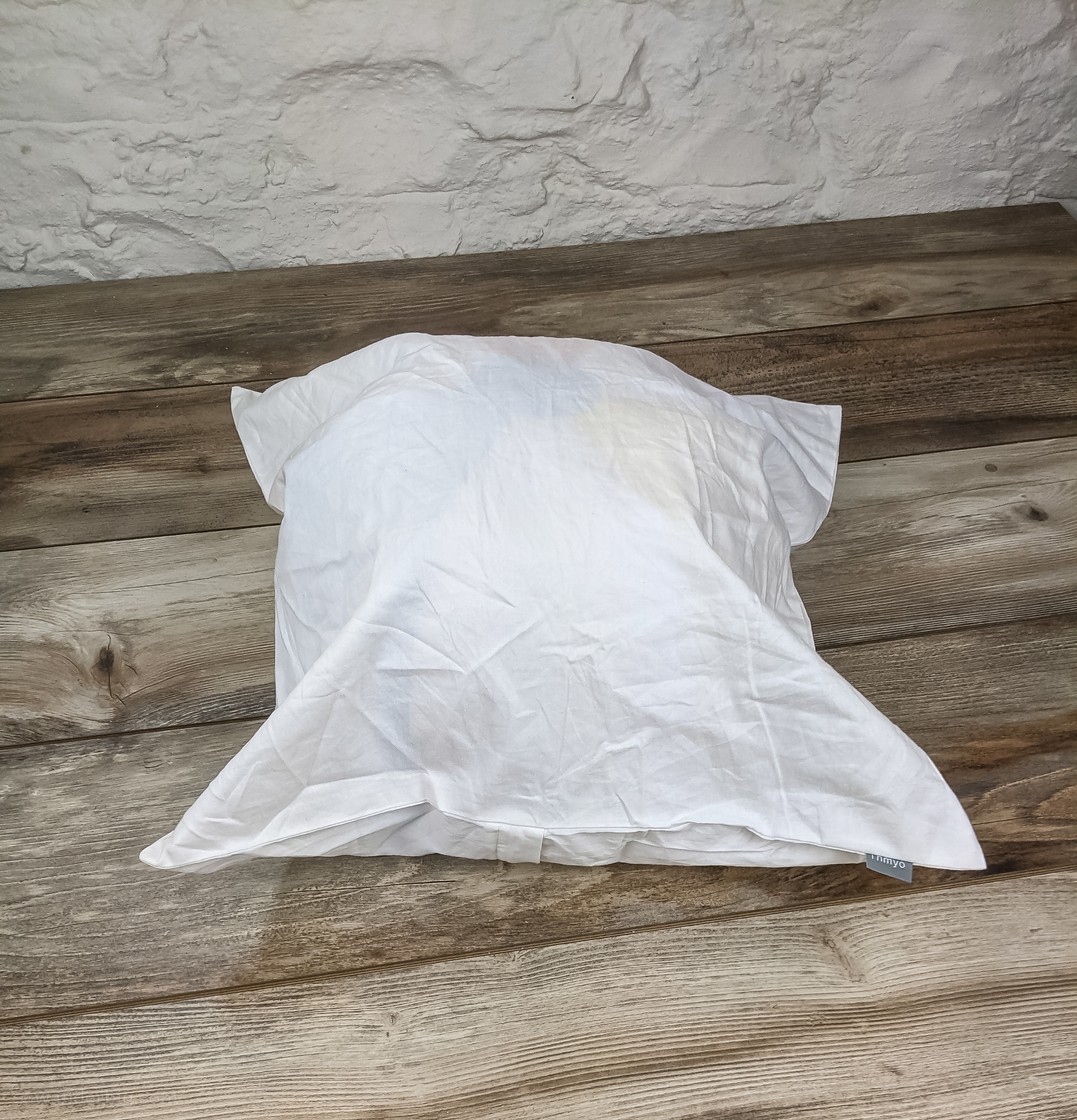 A diy travel pillow made from a beach ball inserted into a pillowcase.
